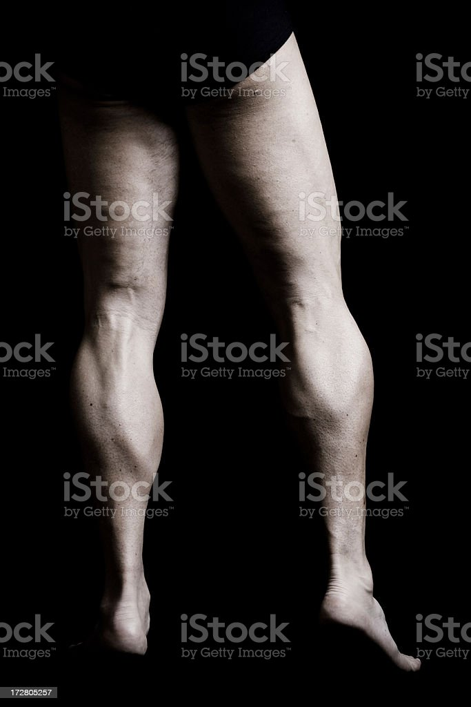Muscular Bodybuilder's Legs royalty-free stock photo