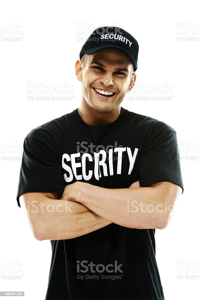 Muscular bouncer standing with arms crossed stock photo