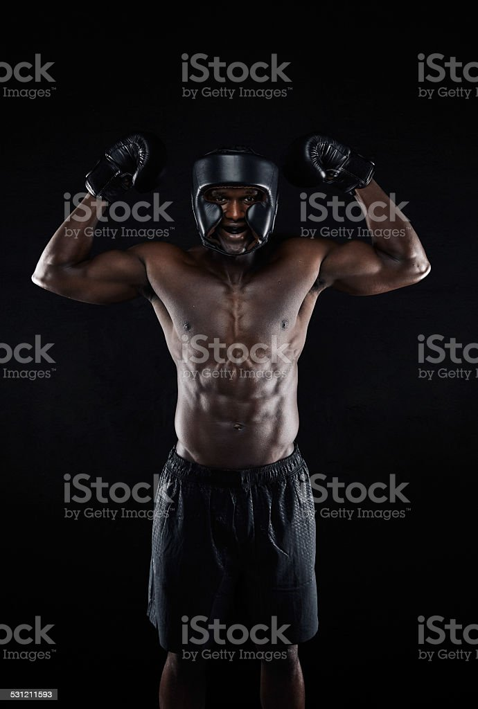 Muscular boxer celebrating his success stock photo