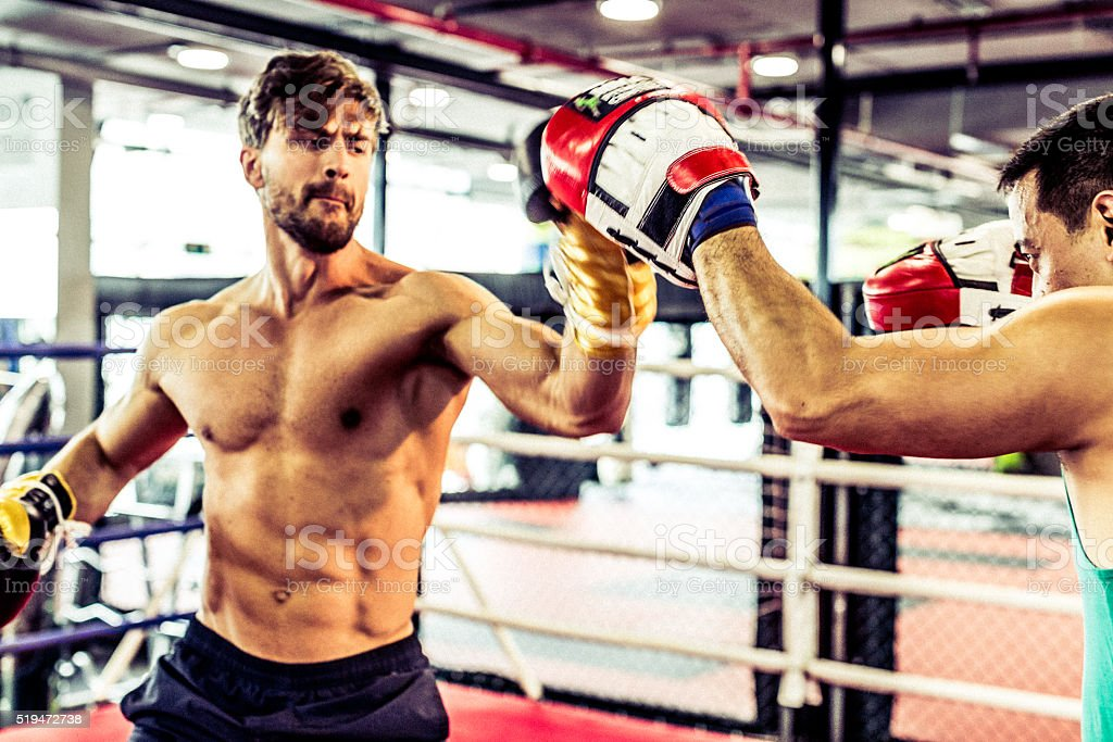 Muscular Boxer Clashing Fists With a Coach stock photo