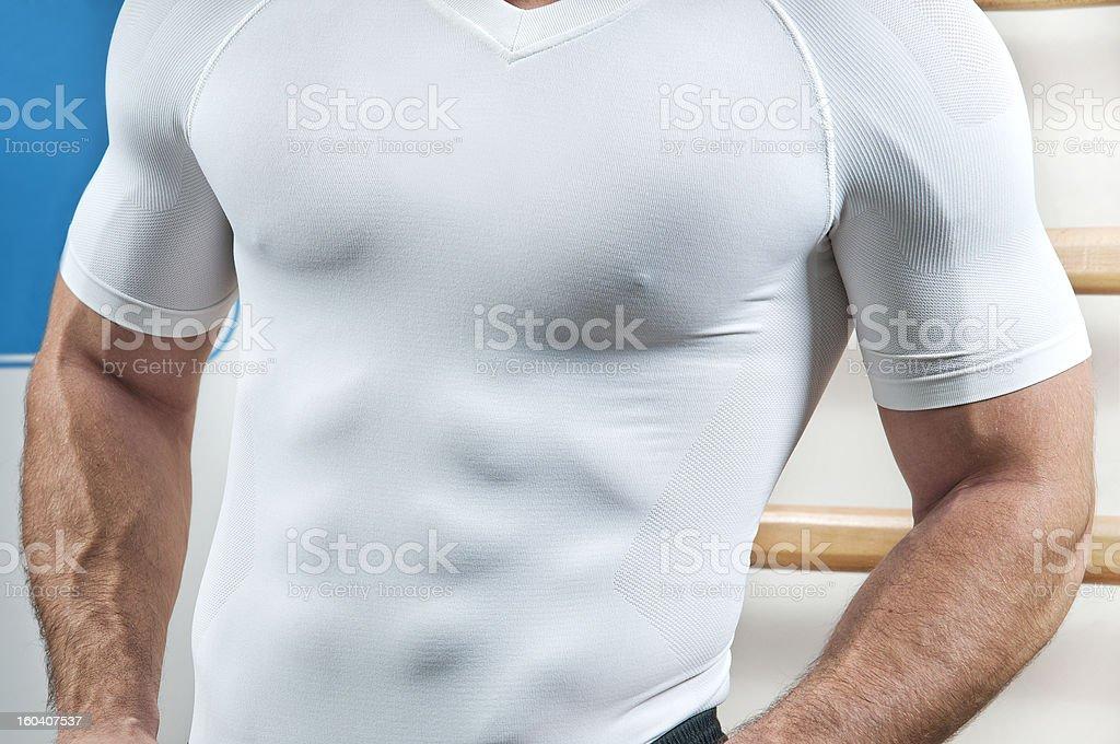 Muscular build through shirt stock photo