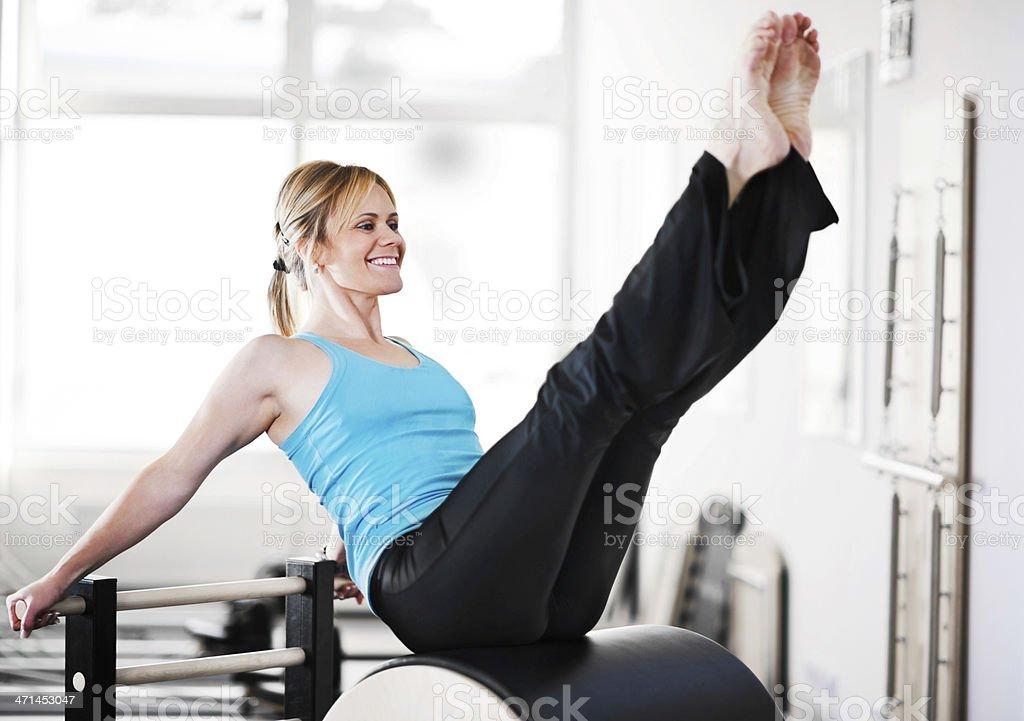 Muscular built woman exercising gymnastics Pilates. royalty-free stock photo