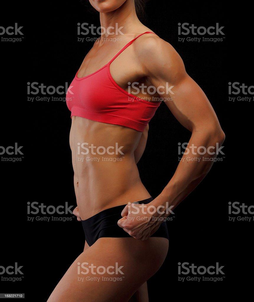 Muscular female body royalty-free stock photo