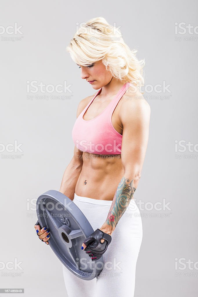 Muscular female holding barbell royalty-free stock photo
