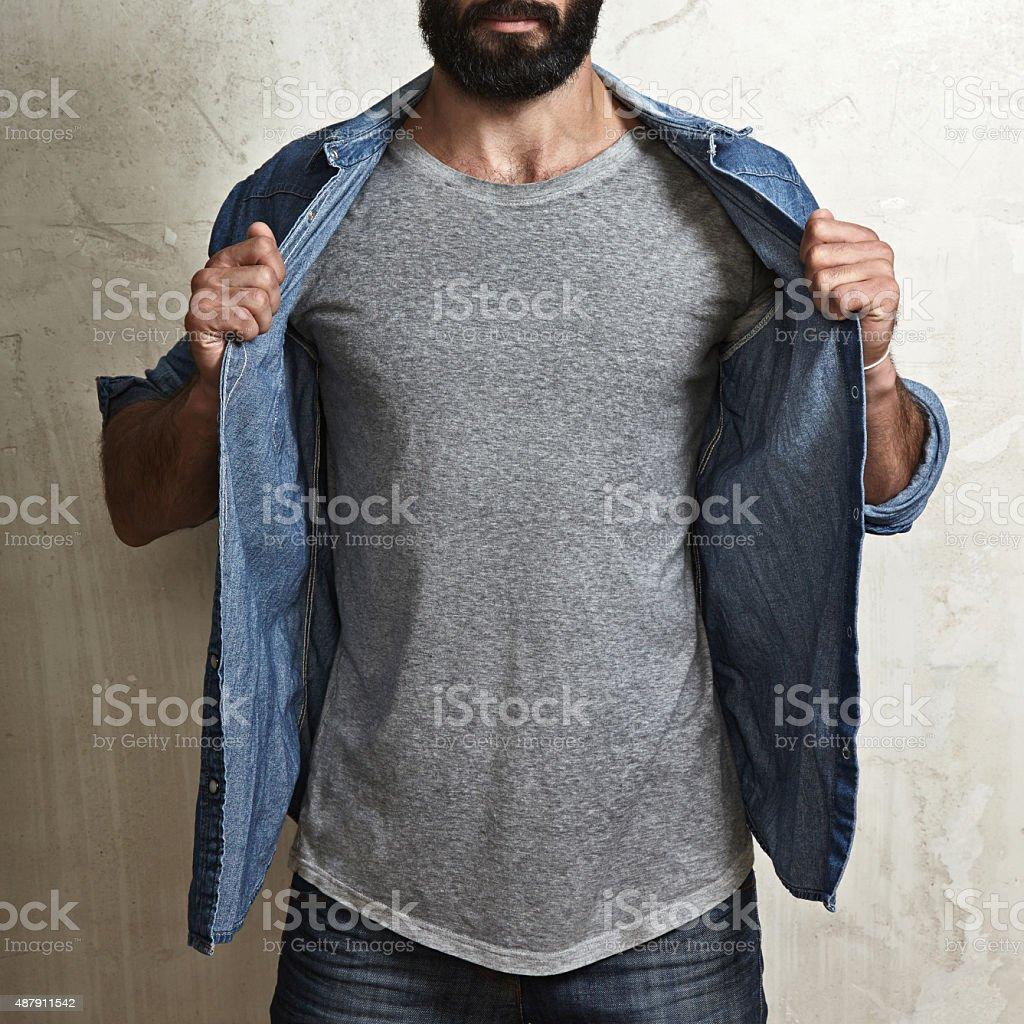 Muscular guy wearing blank grey t-shirt stock photo