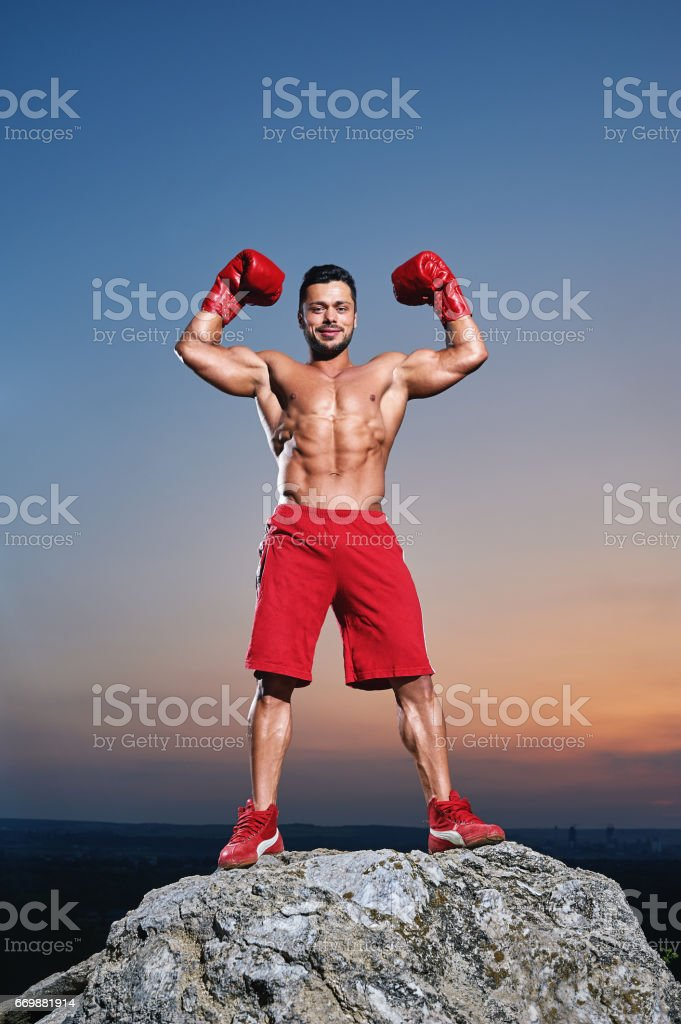 Muscular male boxer training outdoors stock photo