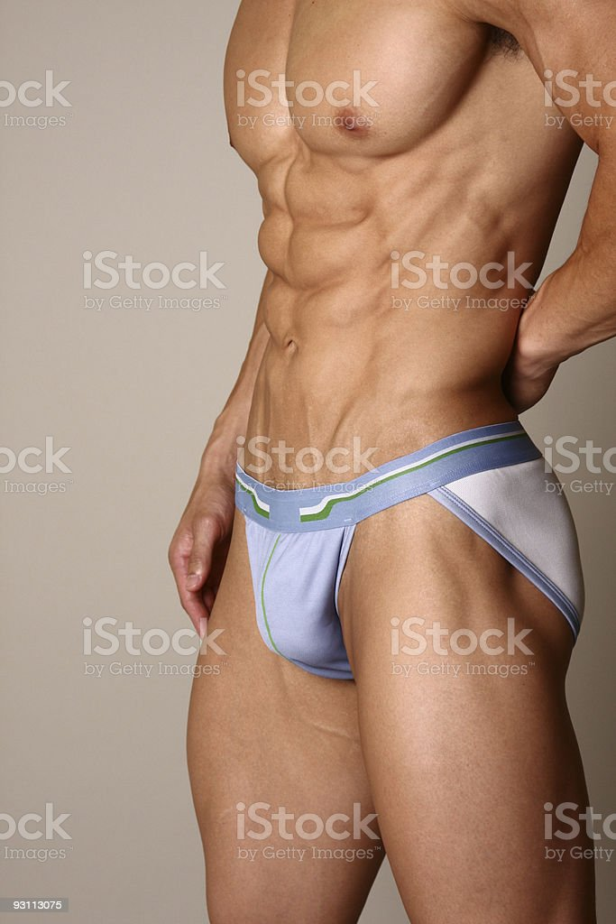 Muscular male fitness model stock photo