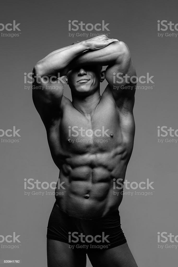 Muscular male posing stock photo