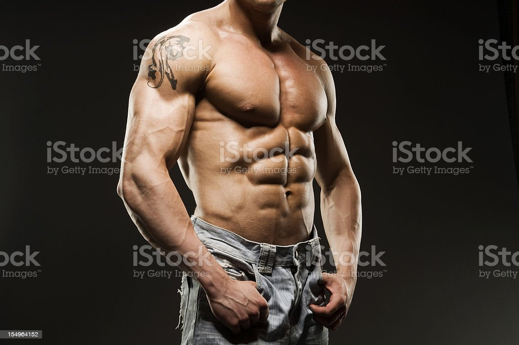Muscular Male Torso in blue jeans royalty-free stock photo