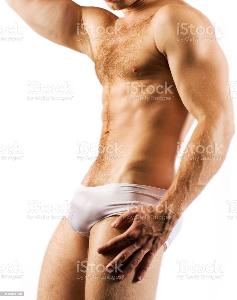 Muscular Male Torso in white shorts royalty-free stock photo