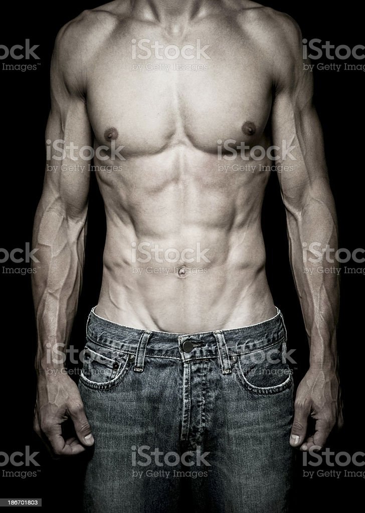 Muscular Male Torso Isolated on Black royalty-free stock photo