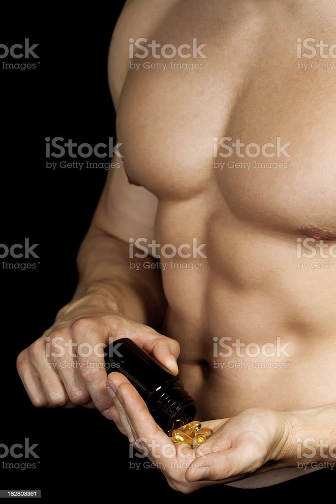 Muscular Male with pills royalty-free stock photo