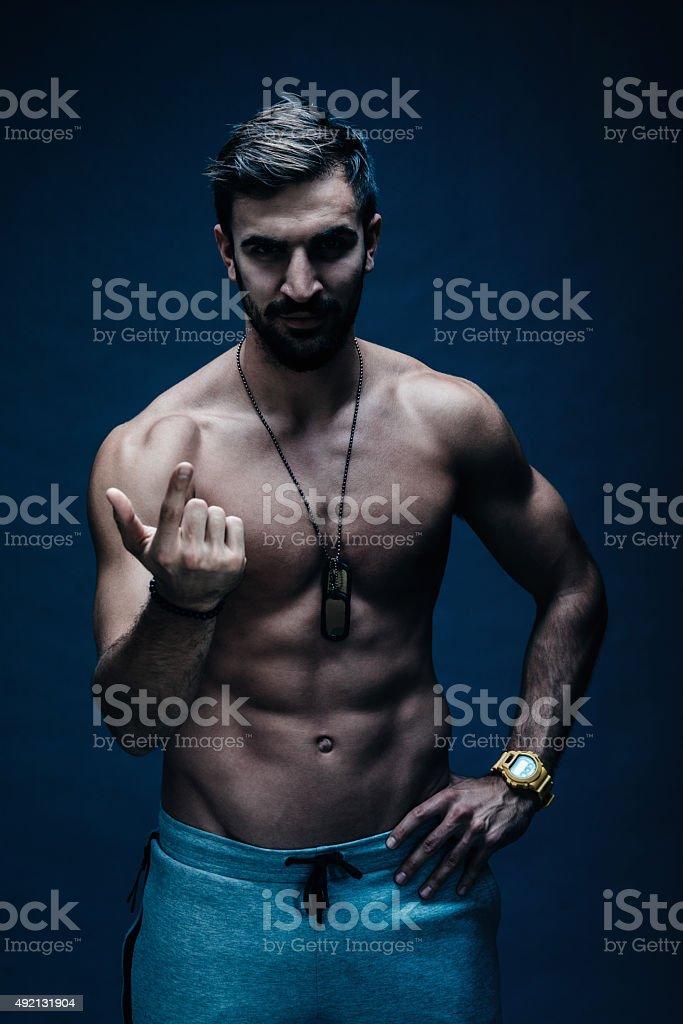 muscular man calling people to start training stock photo
