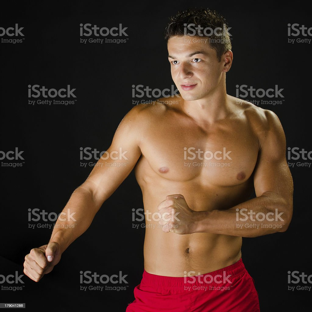 Muscular man defending himself royalty-free stock photo