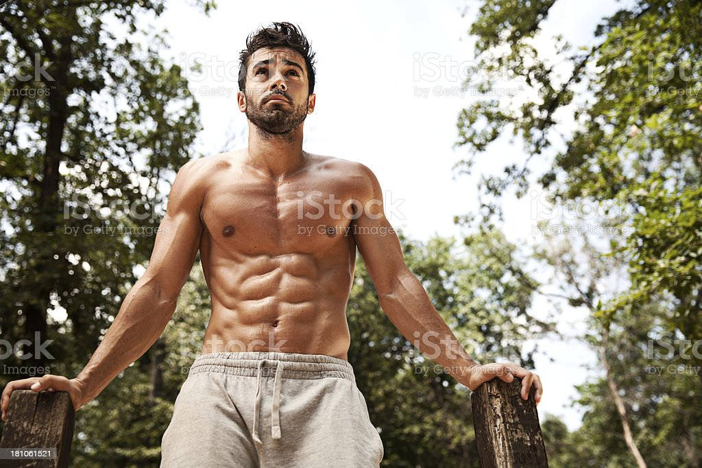 Muscular man doing exercise in park royalty-free stock photo