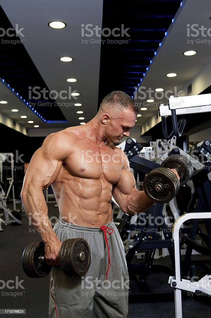 Muscular Man Doing Heavy Dumbbell Exercise for Biceps royalty-free stock photo