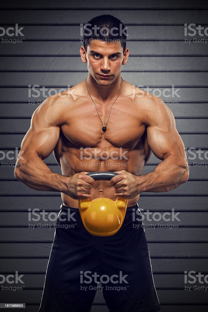Muscular Man Exercise with Kettle Bell royalty-free stock photo