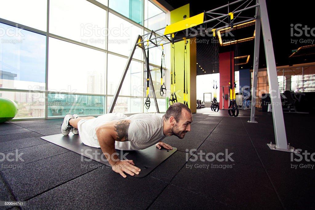 muscular man exercising push ups - Stock Image stock photo