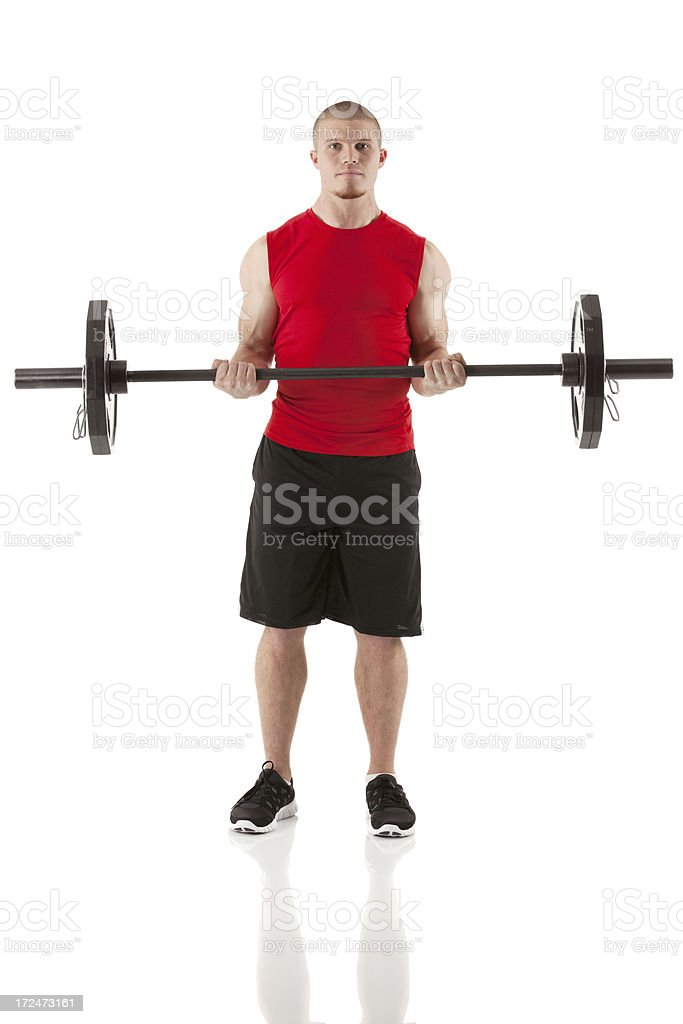 Muscular man exercising with barbell royalty-free stock photo