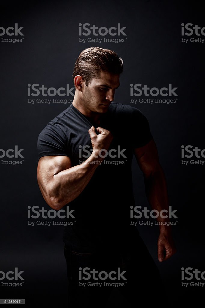 Muscular man flexing muscle stock photo