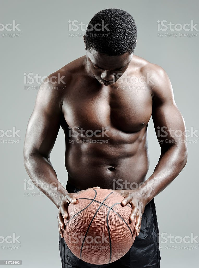 Muscular man holding a basketball royalty-free stock photo