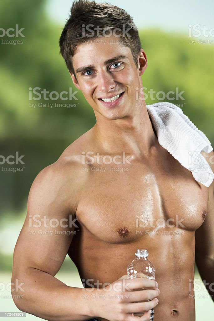 Muscular man holding a waterbottle royalty-free stock photo