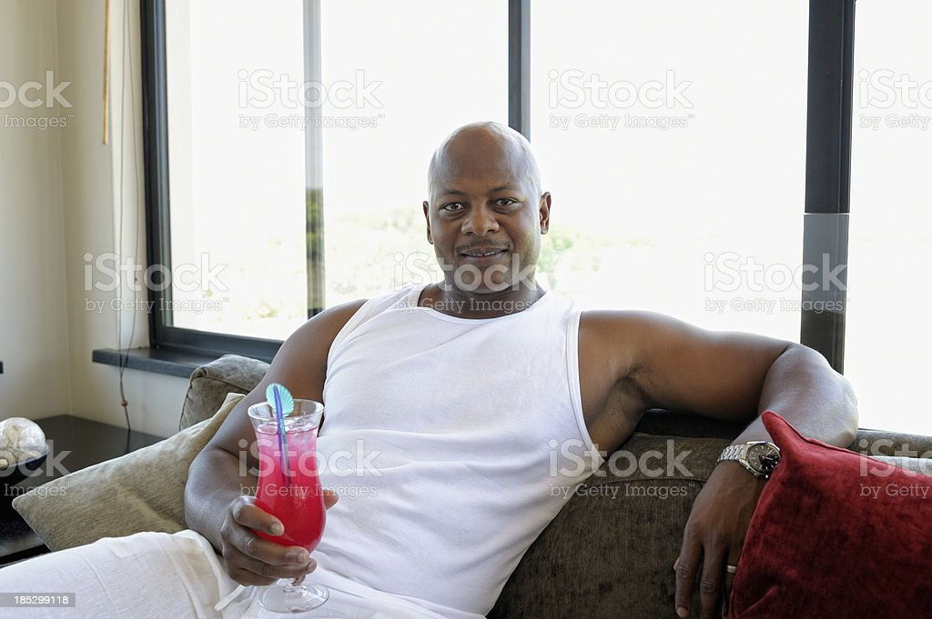 Muscular Man Holding Cocktail stock photo