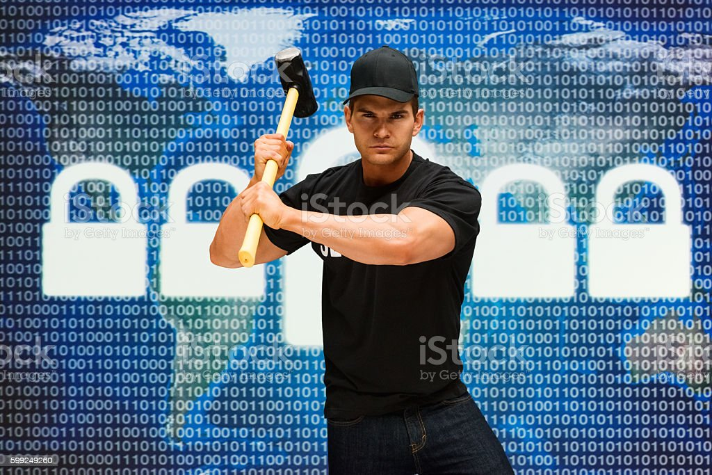 Muscular man in action with sledgehammer stock photo