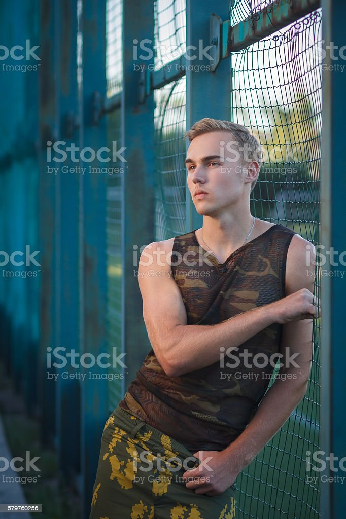 Muscular man in military pants outdoor stock photo