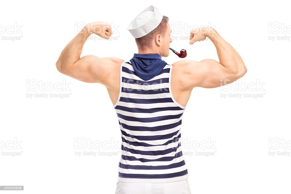 Muscular man in sailor outfit flexing his biceps stock photo