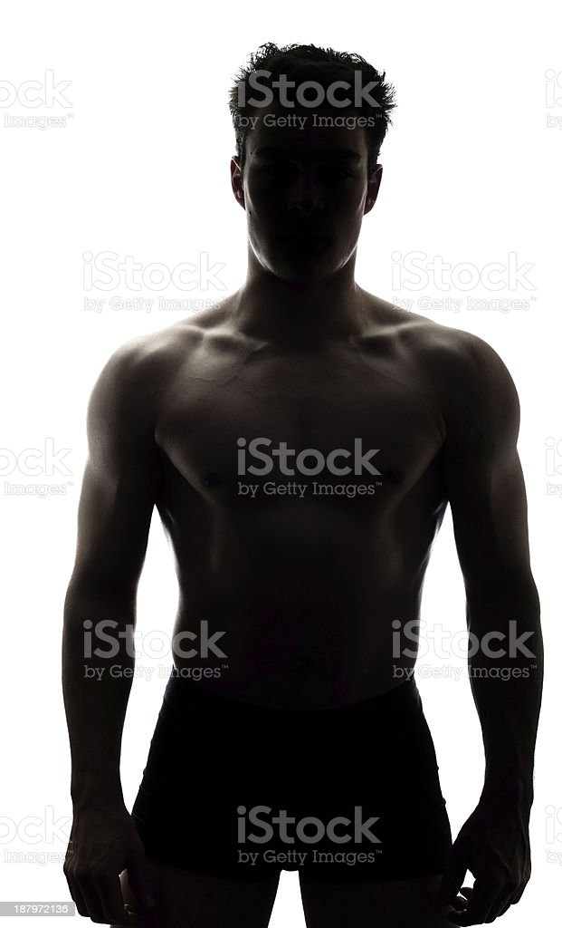 Muscular man in silhouette royalty-free stock photo