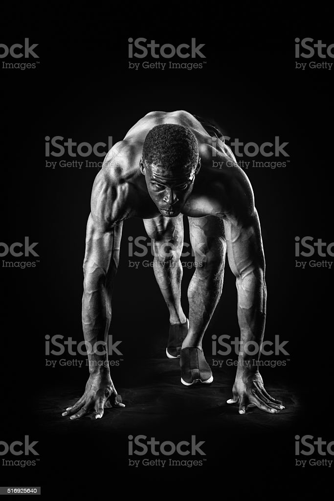 Muscular Man In Starting Position Of A Race stock photo