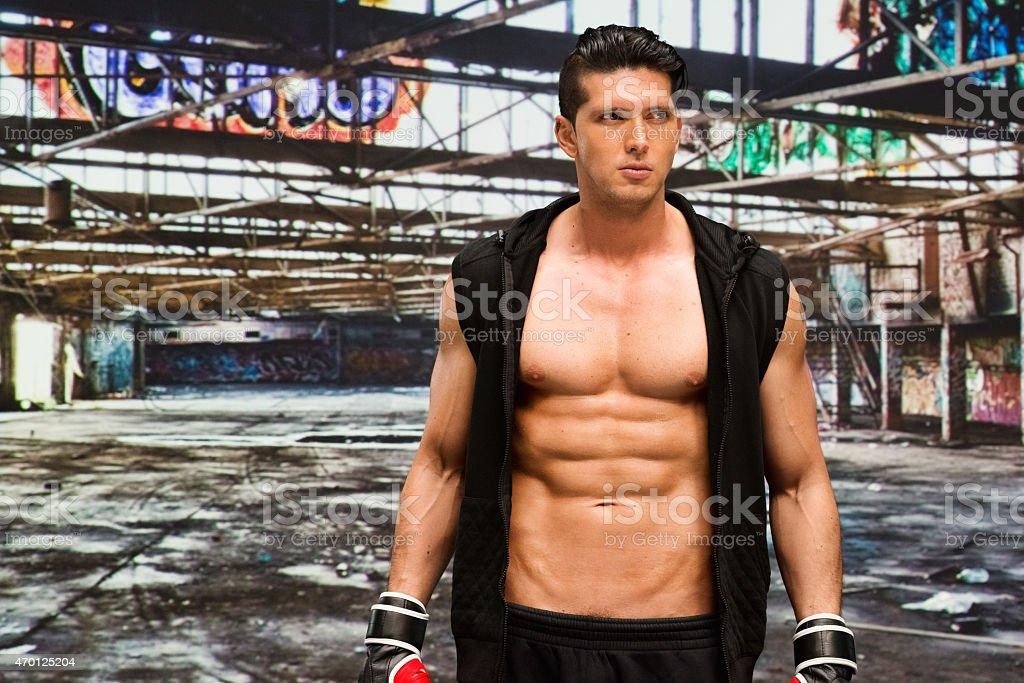 Muscular man in warehouse stock photo