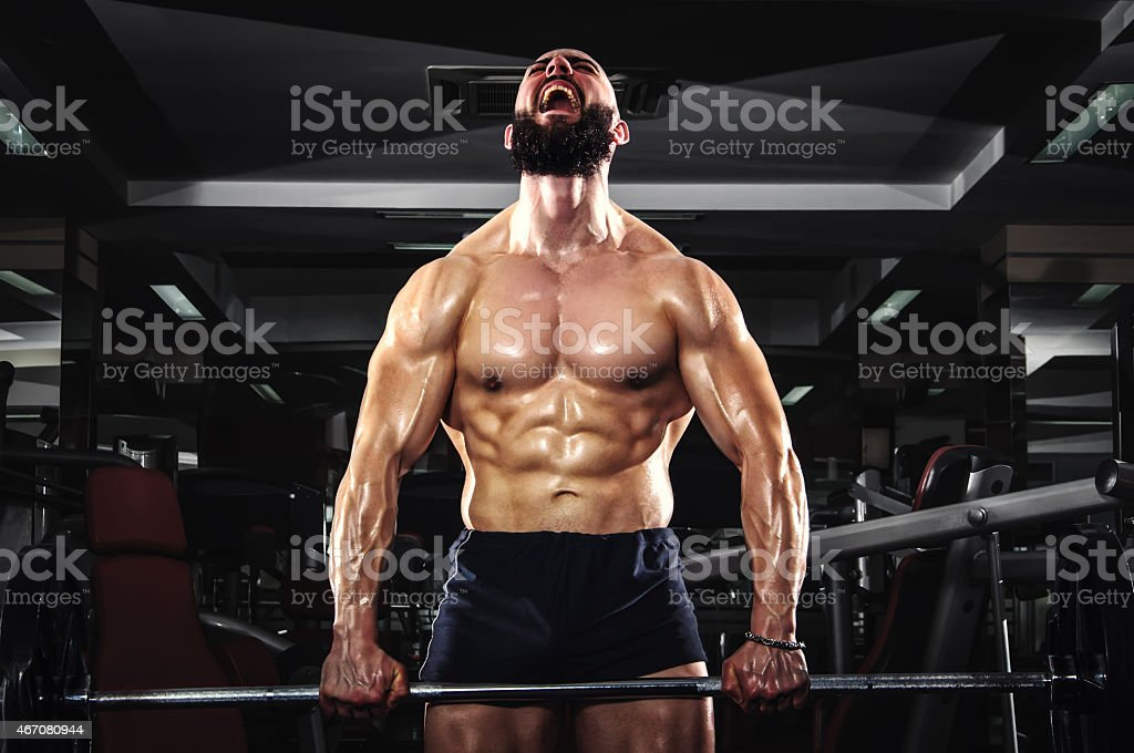Muscular Man Lifting Barbells stock photo