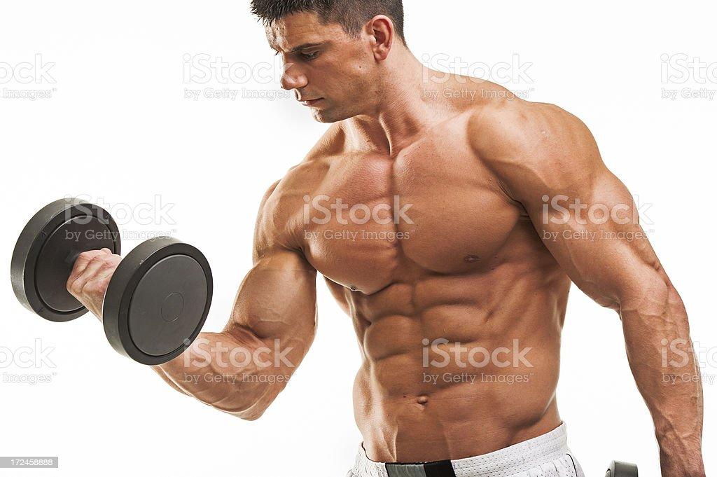 Muscular man lifting weights royalty-free stock photo