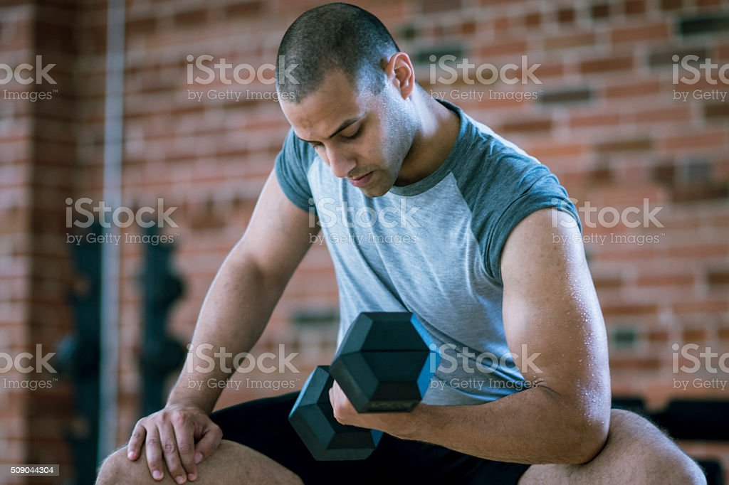 Muscular Man lifting Weights stock photo