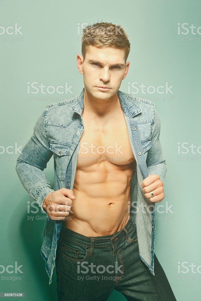 Muscular man looking at camera stock photo