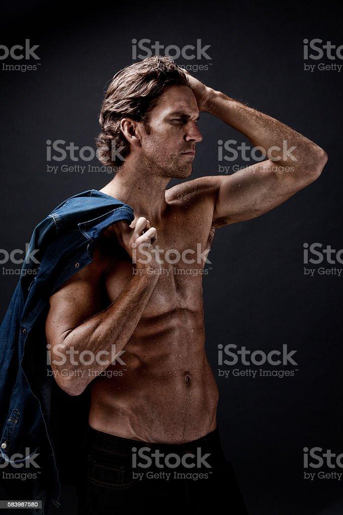 Muscular man looking away stock photo