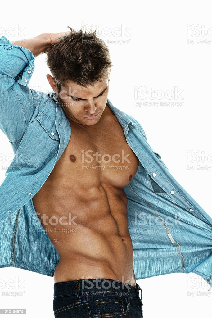 Muscular man looking down stock photo