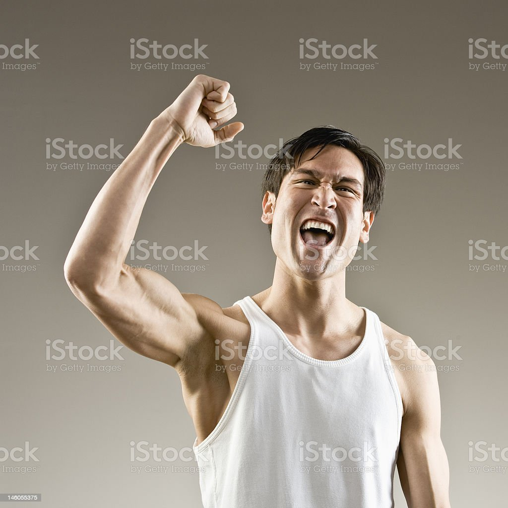 Muscular man making fist and cheering royalty-free stock photo
