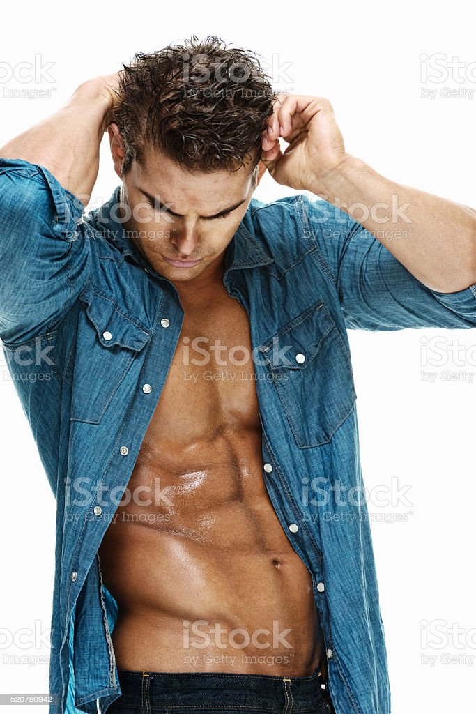 Muscular man posing stock photo