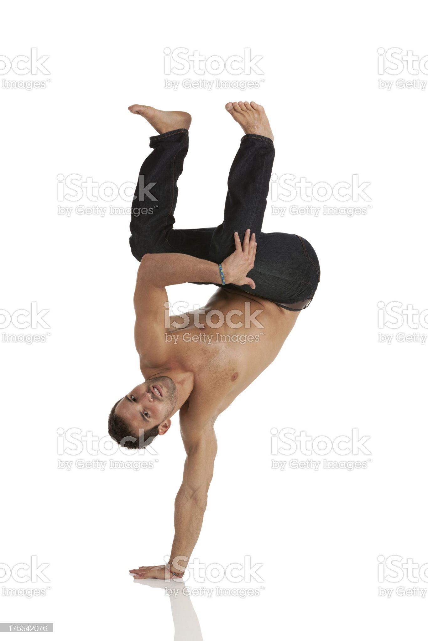 Muscular man practicing capoeira royalty-free stock photo