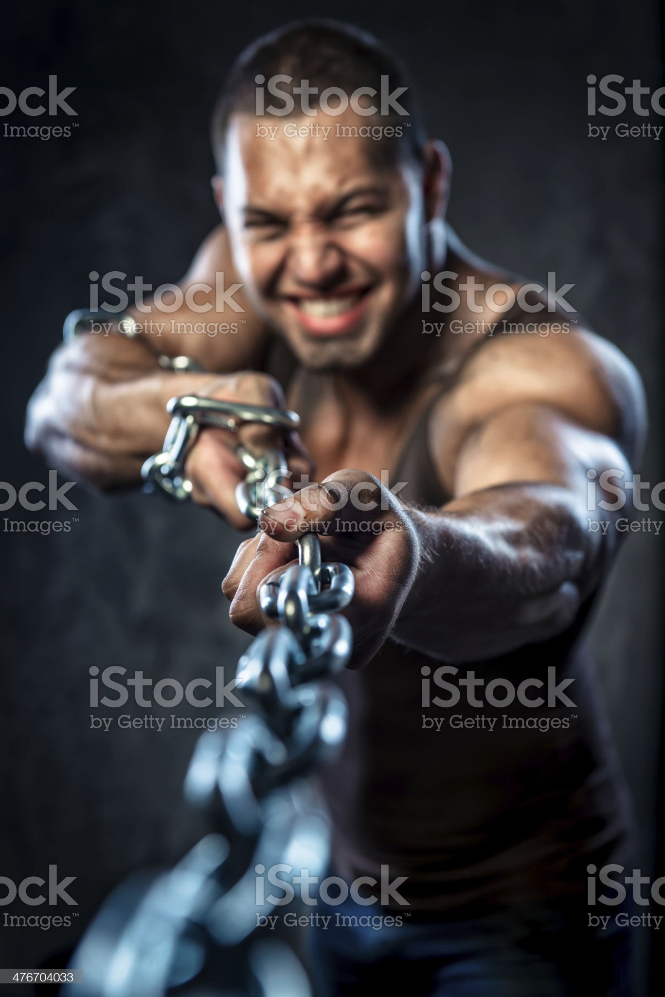 Muscular man pulling the chain royalty-free stock photo