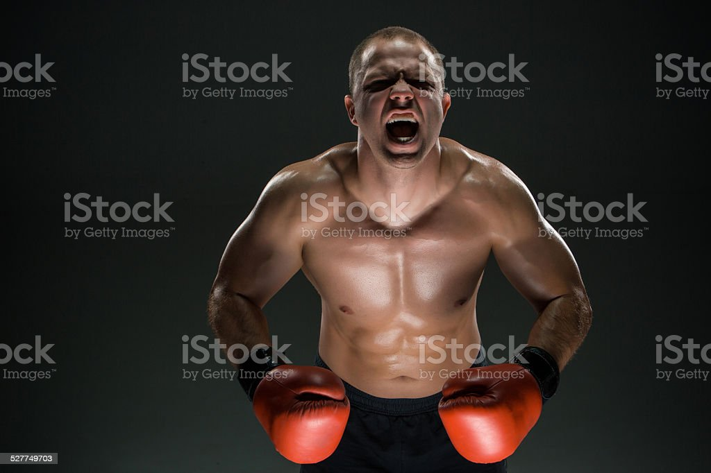 Muscular man screaming and roar stock photo