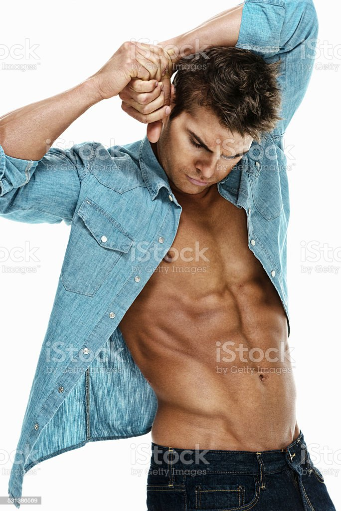 Muscular man showing abdominal muscle stock photo