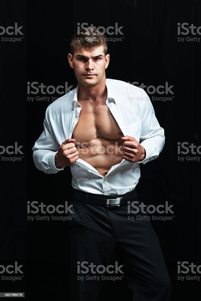 Muscular man showing body stock photo