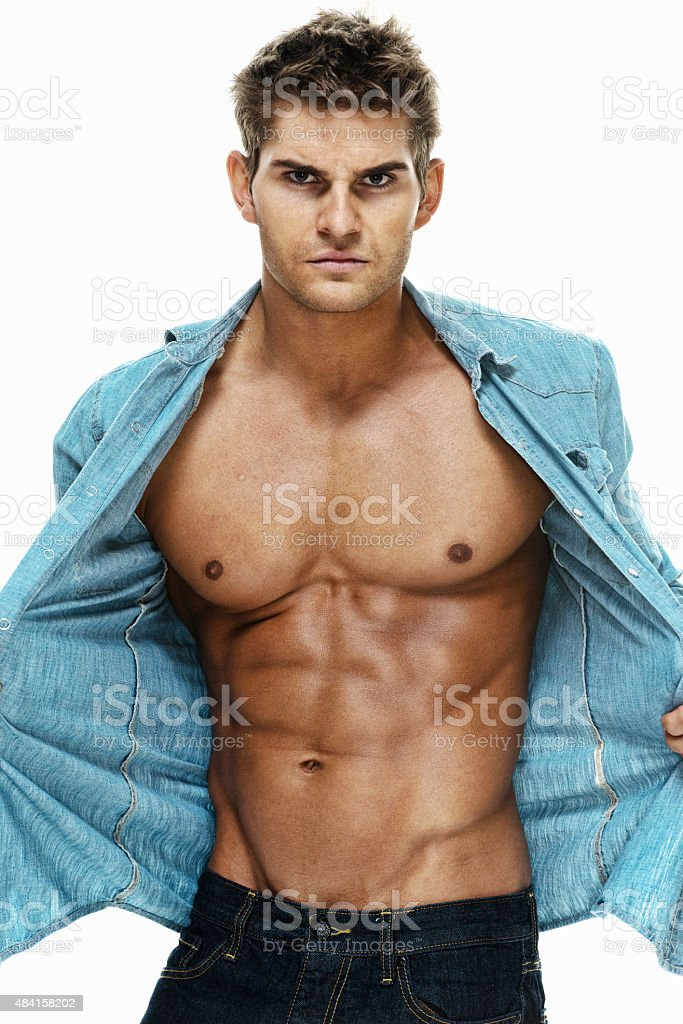 Muscular man showing his body stock photo