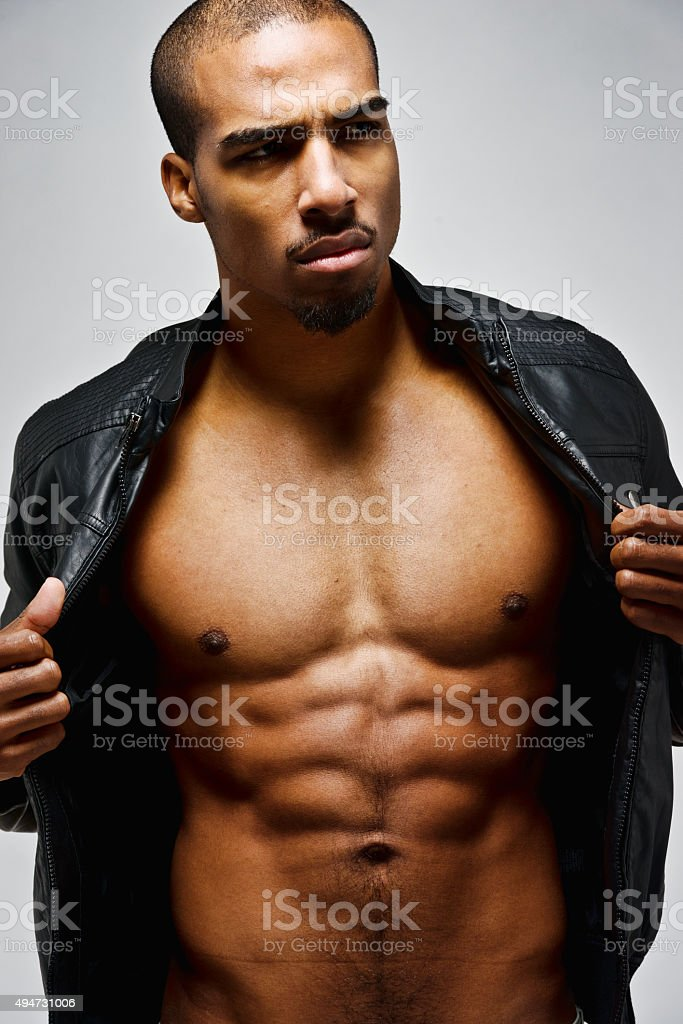 Muscular man sowing his body stock photo
