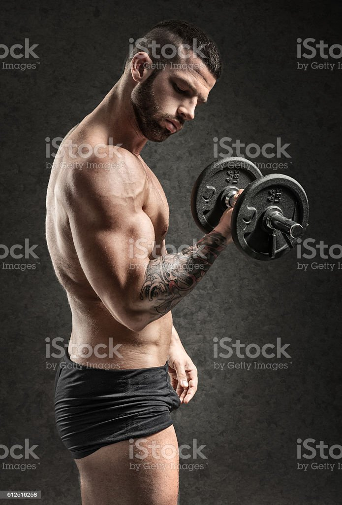 Muscular man - side view - on black background stock photo