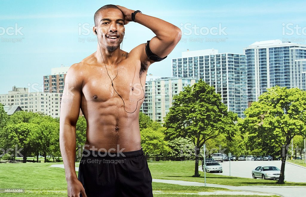 Muscular man standing in front of city royalty-free stock photo